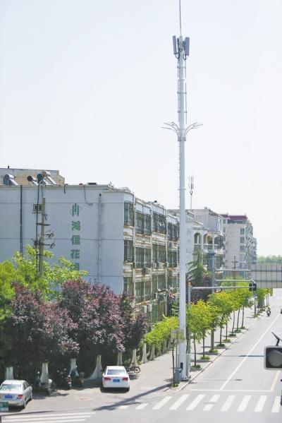 楼前冒出信号塔,居民担心有辐射