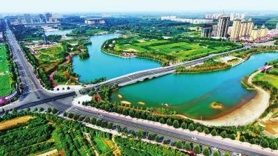 """此外,许昌市还通过实施""""绿满许昌""""行动,规划建成了154个公园,游乐园和"""