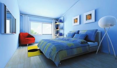 卧室中蓝色冷却了白色的苍白,在花纹床头与床尾凳的装